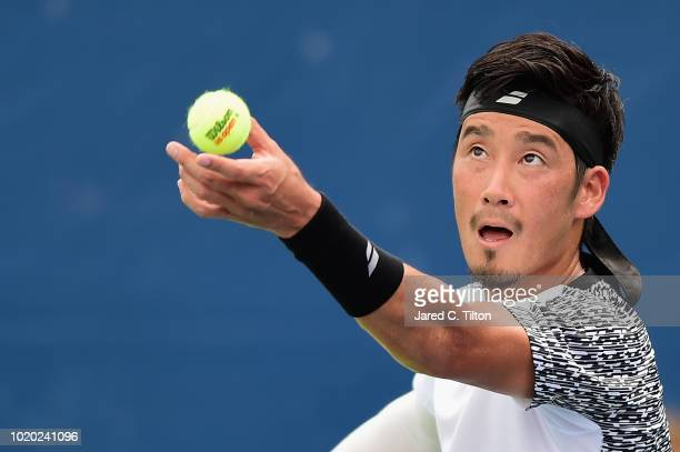 Yuichi Sugita of Japan serves to Leonardo Mayer of Argentina during the first day of the WinstonSalem Open at Wake Forest University on August 20...