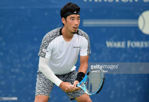 Yuichi Sugita of Japan waits to return a shot from Leonardo Mayer of Argentina during the first day of the WinstonSalem Open at Wake Forest...