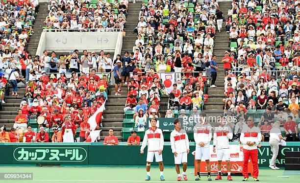 Yuichi Sugita Yoshihito Nishioka Taro Daniel Kei Nishikori and head coach Minoru Ueda of Japan applaud supporters after their win on day two of the...