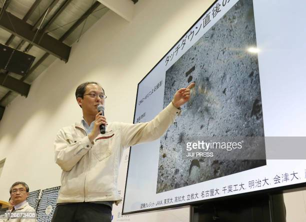 Yuichi Tsuda project engineer of the Hayabusa2 mission from the Japan Aerospace Exploration Agency points at an image showing the surface of the...