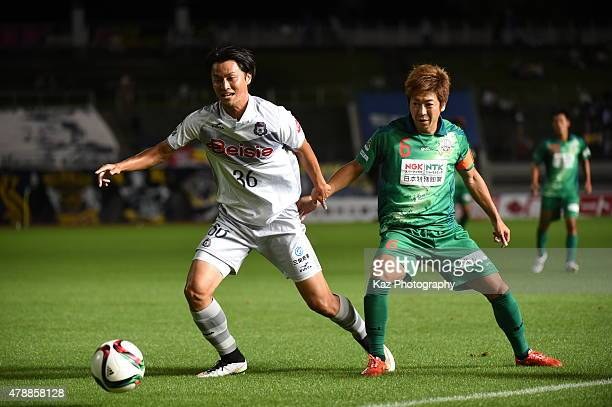 Yuichiro Nagai of Thespakusatsu Gunma and Keiji Takachi of FC Gifu compete for the ball during the JLeague second division match between FC Gifu and...