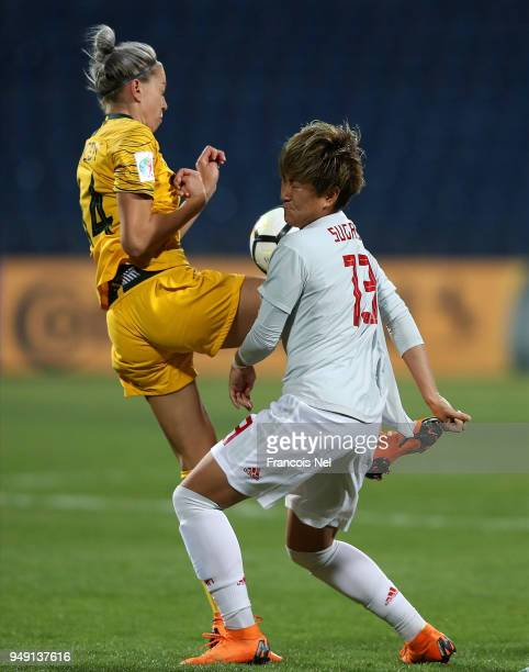 Yuika Sugasawa of Japan and Alanna Kennedy of Australia collide during the AFC Women's Asian Cup final between Japan and Australia at the Amman...