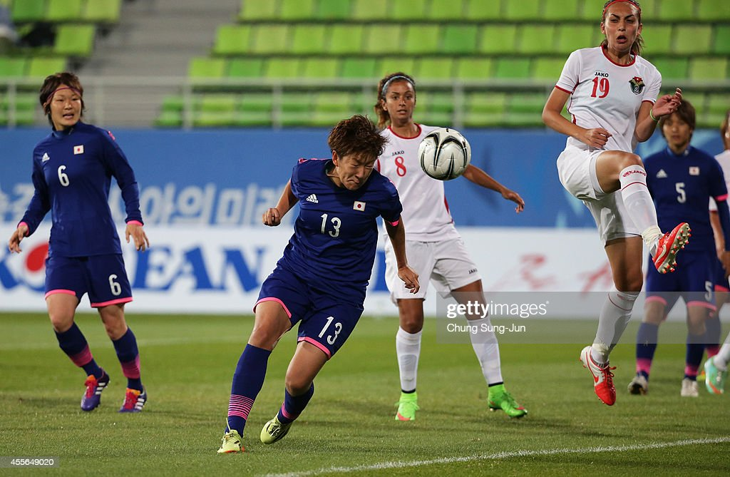 Yuika Sugasawa of Japan in action during the Women's Football Group B match between Japan and Jordan at Namdong Asiad Rugby Field during day -1 of the 17th Asian Games on September 18, 2014 in Incheon, South Korea.