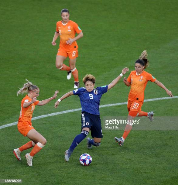 Yuika Sugasawa of Japan is challenged by Jackie Groenen of the Netherlands and Danielle Van De Donk of the Netherlands during the 2019 FIFA Women's...