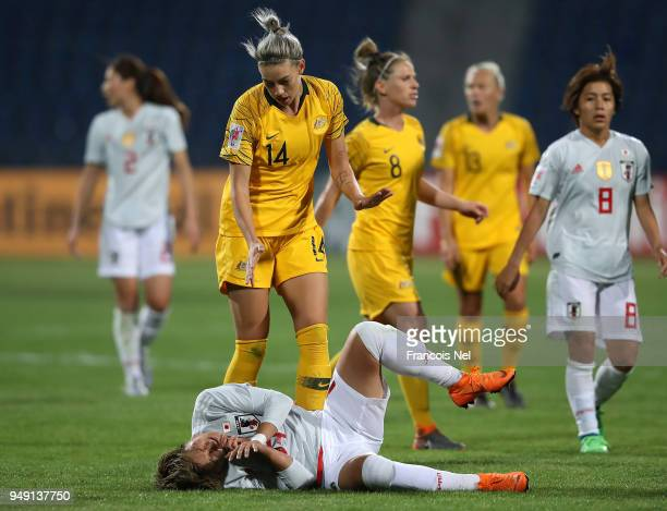 Yuika Sugasawa of Japan lies on the ground after colliding with Alanna Kennedy of Australia during the AFC Women's Asian Cup final between Japan and...