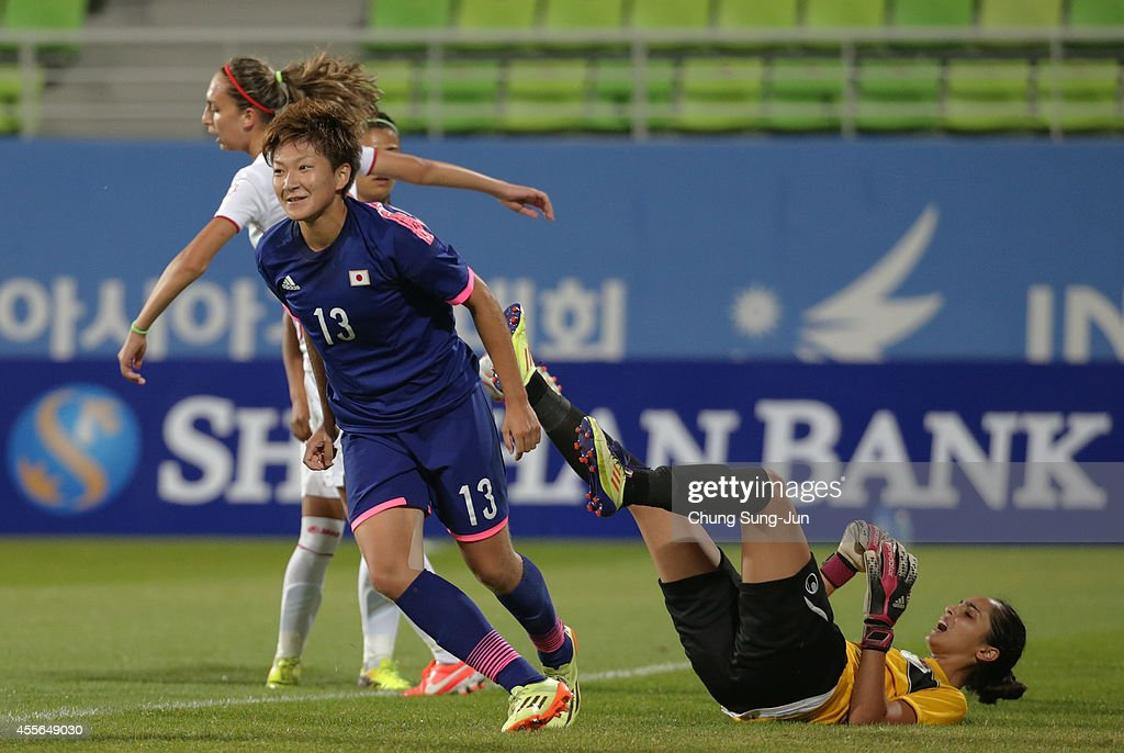 Yuika Sugasawa of Japan reacts after scoring a goal during the Women's Football Group B match between Japan and Jordan at Namdong Asiad Rugby Field during day -1 of the 17th Asian Games on September 18, 2014 in Incheon, South Korea.