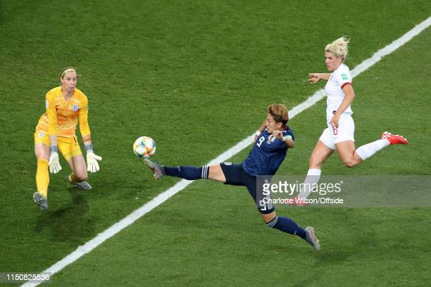 Yuika Sugasawa of Japan stretches for the ball as England goalkeeper Karen Bardsley comes out with Millie Bright of England looking on during the...