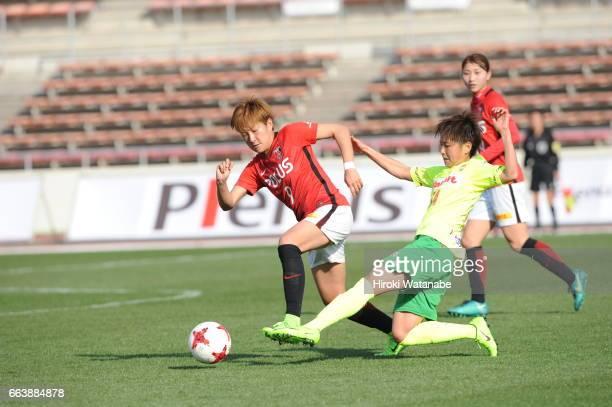 Yuika Sugasawa of Urawa Red Diamonds Ladies and Shouko Chino Shoko of JEF United Chiba Ladies compete for the ball during the Nadeshiko League match...
