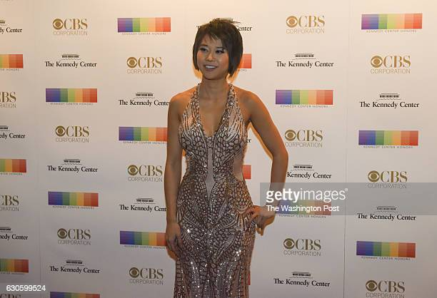 Yuja Wang walks the red carpet at the 2016 Kennedy Center Honors at the Kennedy Center on Sunday December 4 in Washington DC The 2016 honorees...