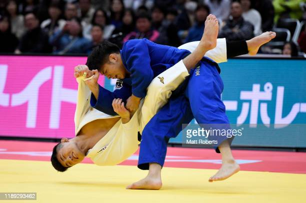 Yuji Aida of Japan and Hifumi Abe of Japan compete in the Men's -66kg semifinal on day one of the Judo Grand Slam at the Maruzen Intec Arena Osaka on...