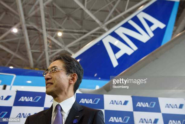 Yuji Hirako president and chief executive officer of All Nippon Airways Co attends an initiation ceremony at the company's hanger in Tokyo Japan on...