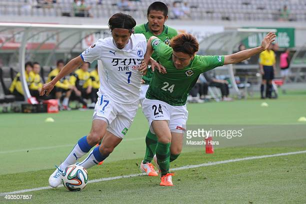 Yuji Kimura of Oita Torinita and Kazuki Anzai of Tokyo Verdy compete for the ball during the J.League second division match between Tokyo Verdy and...