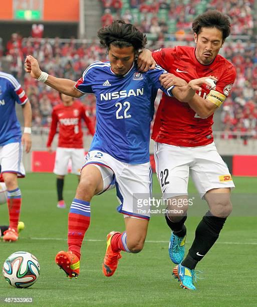 Yuji Nakaazawa of Yokohama FMarinos and Yuki Abe of the Urawa Red Diamonds compete for the ball during the JLeague match between Urawa Red Diamonds...