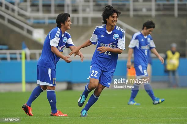 Yuji Nakazawa and Atsuhiro Miura in action during the Atsuhiro Miura Retirement match at Nippatsu Mitsuzawa Stadium on November 4 2013 in Yokohama...