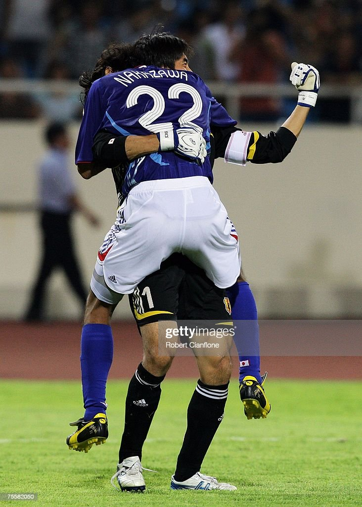 Yuji Nakazawa and goalkeeper Yoshikatsu Kawaguchi of Japan celebrate their 4-3 win over Australia after a penalty shoot-out in the AFC Asian Cup 2007 Quarter Final between Japan and the Australian Socceroos at My Dinh National Stadium July 21, 2007 in Hanoi, Vietnam.