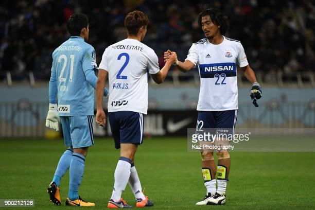 Yuji Nakazawa and Jeong Su Park of Yokohama FMarinos shake the hands after the loss during the 97th All Japan Football Championship final between...