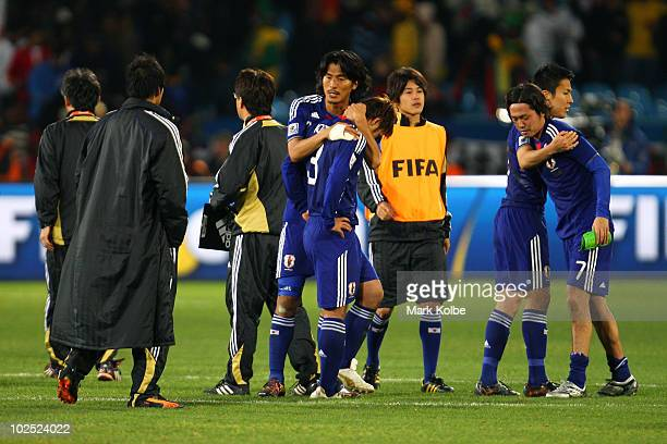 Yuji Nakazawa of Japan consoles Yuichi Komano after he missed in a penalty shoot-out during the 2010 FIFA World Cup South Africa Round of Sixteen...