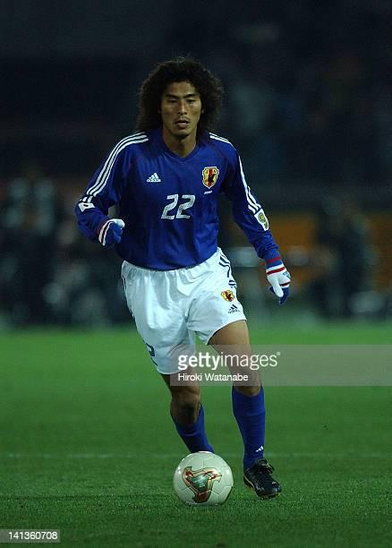 Yuji Nakazawa of Japan in action during the East Asian Football Championship match between Japan and South Korea at Yokohama International Stadium on...