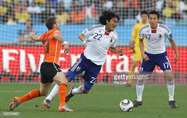 Yuji Nakazawa of Japan is tackled by Rafael Van der Vaart of the Netherlands during the 2010 FIFA World Cup South Africa Group E match between...