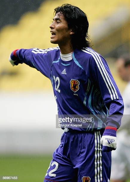 Yuji Nakazawa of Japan issues instructions to the team during the international friendly match between Japan and Bosnia Herzegovina at the Signal...