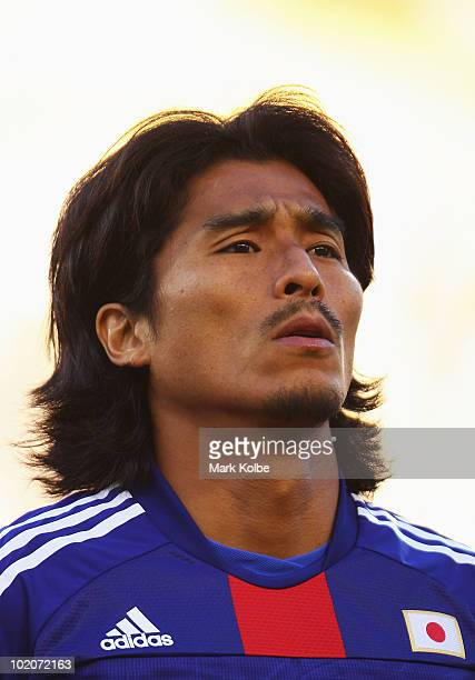 Yuji Nakazawa of Japan lines up for the national anthems prior to the 2010 FIFA World Cup South Africa Group E match between Japan and Cameroon at...