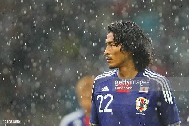 Yuji Nakazawa of Japan watches on in the rain during the International Friendly between Japan and England at UPCArena on May 30 2010 in Graz Austria