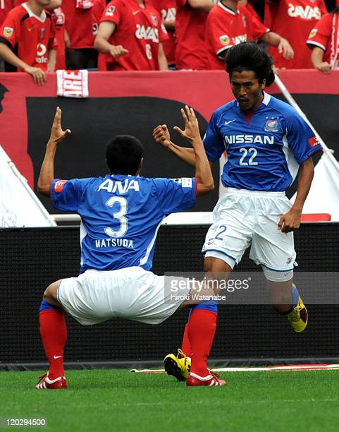 Yuji Nakazawa of Yokohama F Marinos celebrates the first goal with his teammate Naoki Matsuda during the JLeague match between Urawa Red Diamonds and...