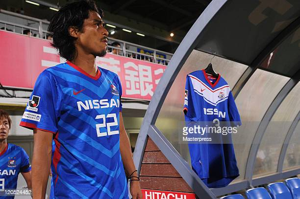 Yuji Nakazawa of Yokohama F Marinos walk past former Japanese international defender Naoki Matsuda 's shirt hangs on the bench during the JLeague...