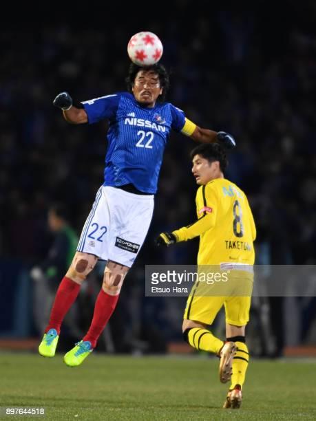 Yuji Nakazawa of Yokohama FMarinos and Kosuke Taketomi of Kashiwa Reysol compete for the ball during the 97th Emperor's Cup semi final match between...