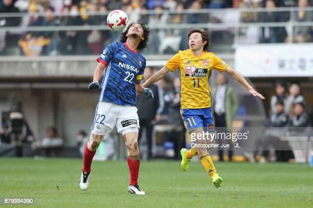 Yuji Nakazawa of Yokohama FMarinos and Naoki Ishihara of Vegalta Sendai compete for the ball during the JLeague J1 match between Vegalta Sendai and...
