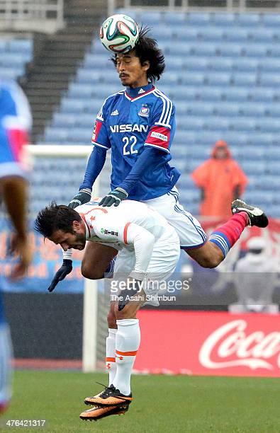 Yuji Nakazawa of Yokohama FMarinos and Zlatan Ljubijankic of Omiya Ardija compete for the ball during the J League match between Yokohama F Marinos...