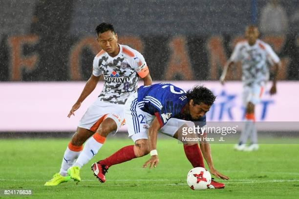 Yuji Nakazawa of Yokohama FMarinos controls the ball under pressure of Chong Tese of Shimizu SPulse during the JLeague J1 match between Yokohama...