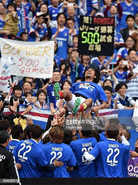 Yuji Nakazawa of Yokohama FMarinos up in the air after the JLeague match between Yokohama FMarinos and Vissel Kobe at Nissan Stadium on October 17...