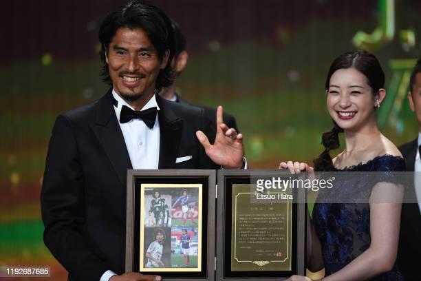 Yuji Nakazawa receives Special Service Award from Rika Adachi during the J.League Awards on December 08, 2019 in Tokyo, Japan.