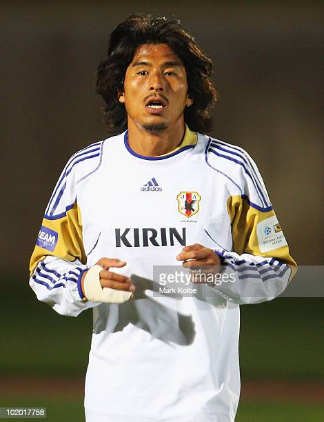 Yuji Nakazawa runs a lap of the field during a Japan training session at the Central University of Technology, Free State ground on June 12, 2010 in...