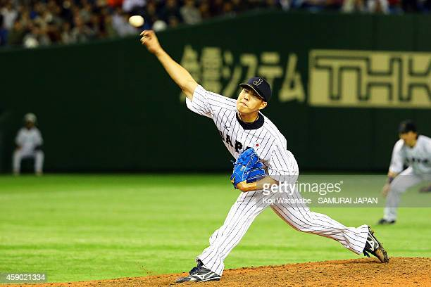 Yuji Nishino of Samurai Japan pitches in the ninth inning during the game three of Samurai Japan and MLB All Stars at Tokyo Dome on November 15, 2014...