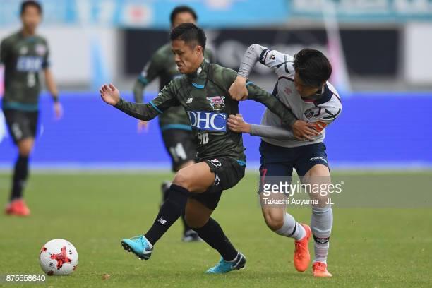 Yuji Ono of Sagan Tosu and Kento Hashimoto of FC Tokyo compete for the ball during the JLeague J1 match between Sagan Tosu and FC Tokyo at Best...