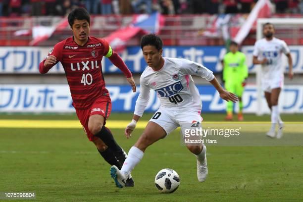 Yuji Ono of Sagan Tosu and Mitsuo Ogasawara of Kashima Antlers compete for the ball during the JLeague J1 match between Kashima Antlers and Sagan...