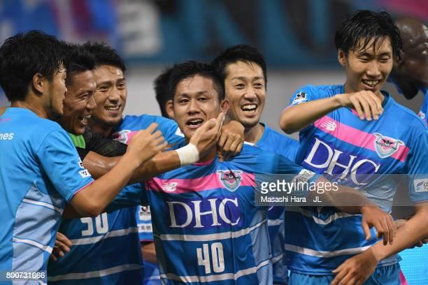 Yuji Ono of Sagan Tosu celebrates scoring the opening goal with his team mates during the JLeague J1 match between Sagan Tosu and Urawa Red Diamonds...