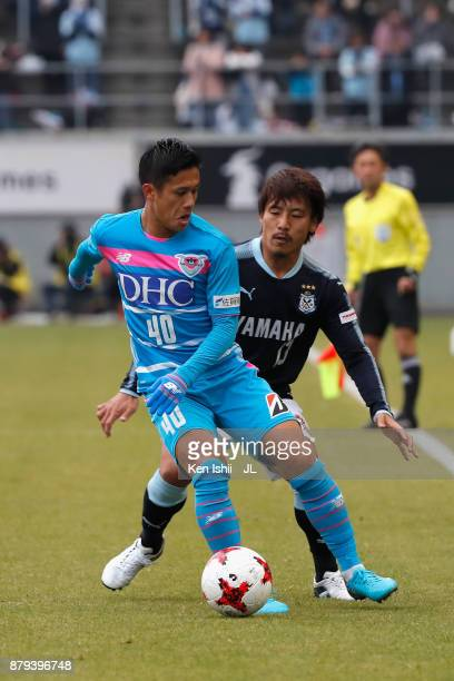 Yuji Ono of Sagan Tosu controls the ball under pressure of Tomohiko Miyazaki of Jubilo Iwata during the JLeague J1 match between Sagan Tosu and...
