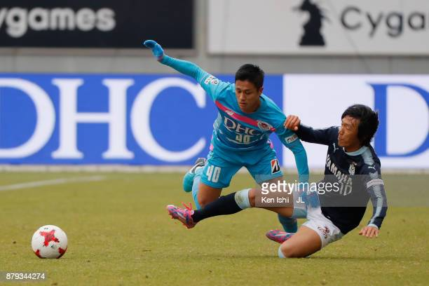Yuji Ono of Sagan Tosu is challenged by Shunsuke Nakamura of Jubilo Iwata during the JLeague J1 match between Sagan Tosu and Jubilo Iwata at Best...