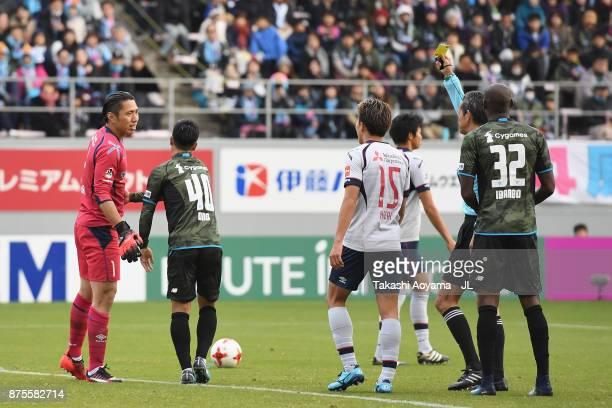 Yuji Ono of Sagan Tosu is shown a yellow card by referee Itaru Hirose during the JLeague J1 match between Sagan Tosu and FC Tokyo at Best Amenity...