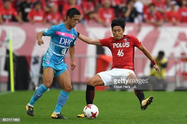 Yuji Ono of Sagan Tosu takes on Ryota Moriwaki of Urawa Red Diamonds during the JLeague J1 match between Urawa Red Diamonds and Sagan Tosu at Saitama...