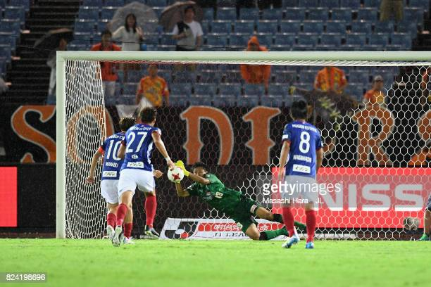 Yuji Rokutan of Shimizu SPulse saves a penalty by Manabu Saito of Yokohama FMarinos during the JLeague J1 match between Yokohama FMarinos and Shimizu...