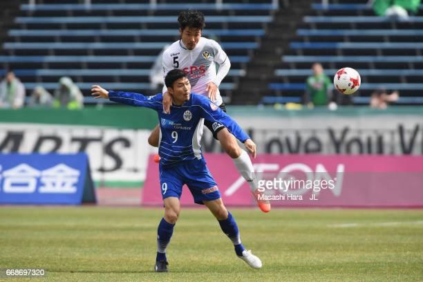 Yuji Senuma of Montedio Yamagata controls the ball under pressure of Tomohiro Taira of Tokyo Verdy during the JLeague J2 match between Montedio...