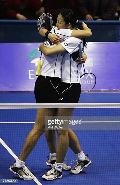 Yujia Li of Singapore hugs Yanmei Jiang following their Womens Doubles Final win against Pek Siah Lim and Swee Ling Quay of Malaysia in the New...