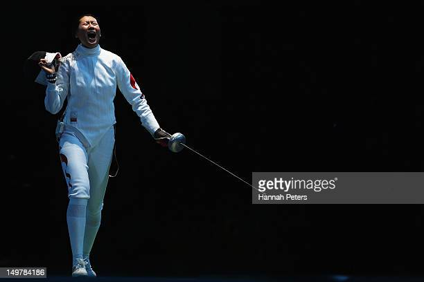 Yujie Sun of China celebrates beating Britta Heidemann of Germany during the Women's Epee Team Fencing quarterfinals on Day 7 of the London 2012...