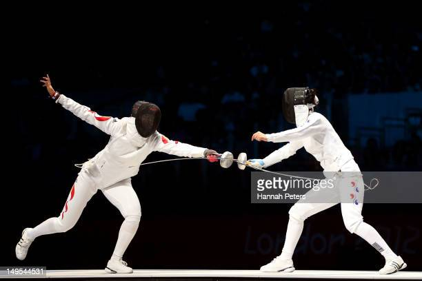 Yujie Sun of China competes against A Lam Shin of Korea during the Bronze Medal Bout in the Women's Epee Individual Fencing on Day 3 of the London...