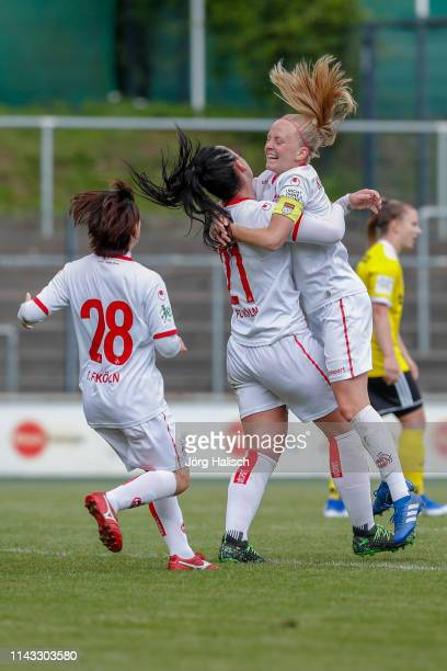 Yuka Hirano and Peggy Nietgen and Anna Kirschbaum of Koeln celebrate their goal during the women's second Bundesliga match between 1FC Koeln and 1FC...