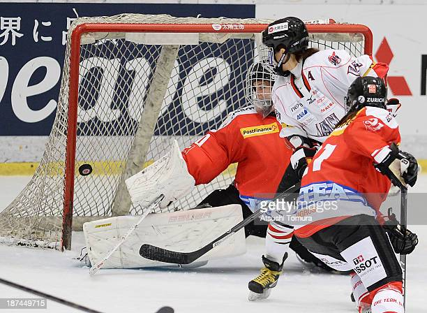 Yuka Hirano of Japan shoots the puck into the back of the net past Florence Schelling of Switzerland in the match between Japan and Switzerland...
